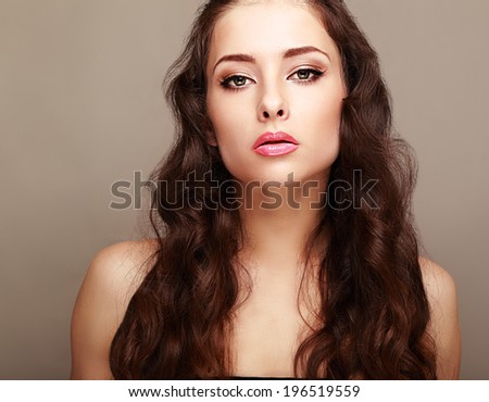 Beautiful female model with bright makeup and curly hair - stock photo