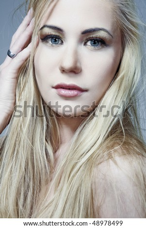 Beautiful female model with long blond hair.