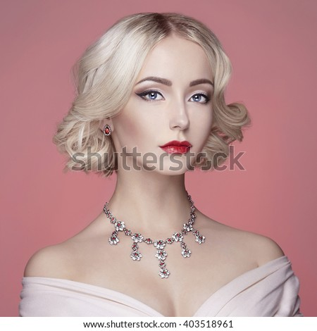 Beautiful female model with makeup with jewelry on her head.beautiful young woman with accessories.fashionable blond lady - stock photo