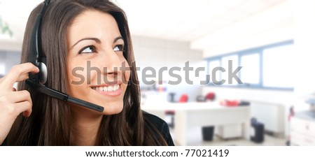 Beautiful female phone operator - stock photo