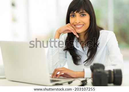 beautiful female photographer sitting in office