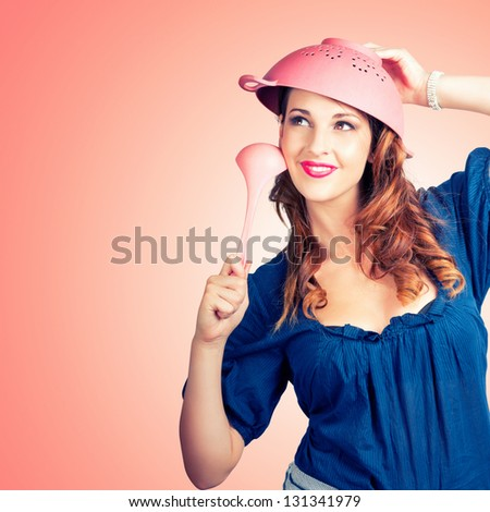 Beautiful Female Pin-up Chef Thinking Up Creative Cooking Ideas With Pink Sieve And Soup Spoon - stock photo