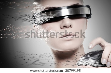 Beautiful female robot with computer mouse - stock photo