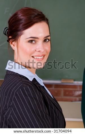 beautiful female school teacher portrait - stock photo