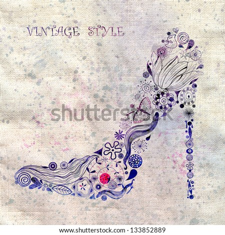 beautiful female shoe of floral ornament on textural background - stock photo