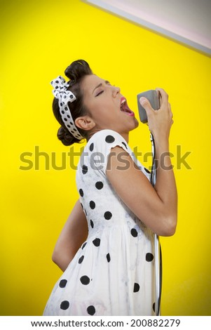 beautiful female singer in fifties style - stock photo
