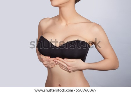 Beautiful female slim body .  Clean skin.  Ideal waist, perfect buttocks and legs, sexy back.  Perfect   young body of the girl .  Fitness or plastic surgery and aesthetic cosmetology.