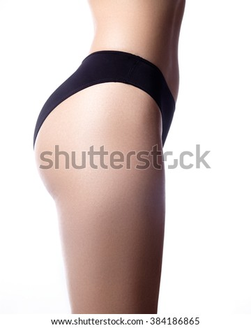 Beautiful female slim body on white. Beauty part of female body. Woman's shape with clean skin. Diet and fitness.Healthy lifestyle. Ideal waist, flat stomack, perfect buttocks and legs, sexy back. - stock photo
