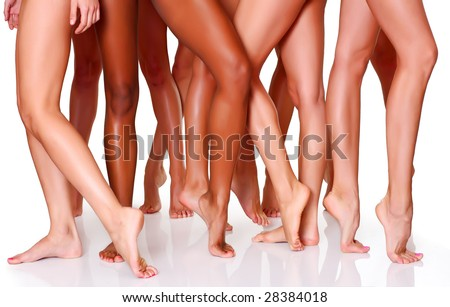Beautiful female slim feet of group of girls, isolated on a white background, please see some of my other parts of a body images: - stock photo