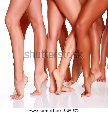 Beautiful female slim feet of group of girls, isolated on a white background, please see some of my other parts of a body images - stock photo