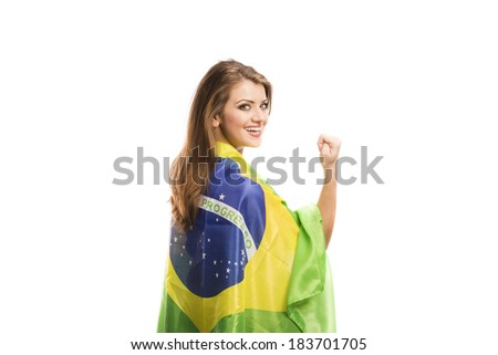 Beautiful female sports fan with brazilian flag isolated on white background - stock photo