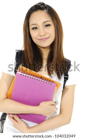 Beautiful female student carrying notebooks isolated over a white background - stock photo