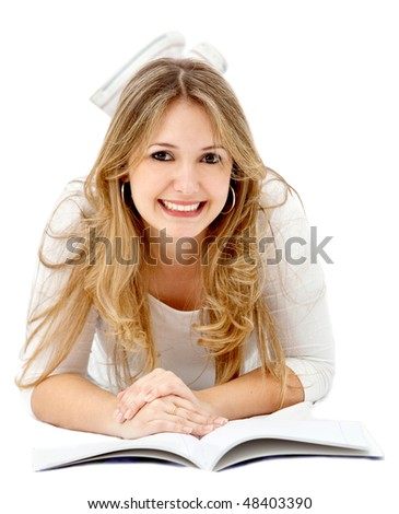 Beautiful female student lying on the floor with a notebook isolated over a white background