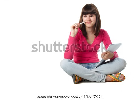 beautiful female student thinking with note pad isolated on white - stock photo