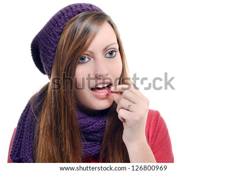 beautiful female taking tablet against a white background - stock photo