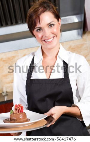 beautiful female waitress presenting plate of dessert