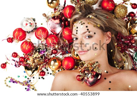 Beautiful female with Christmas decorations on white - stock photo