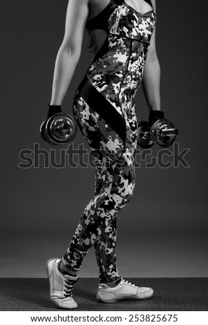 beautiful female with dumbbells. black and white photo - stock photo