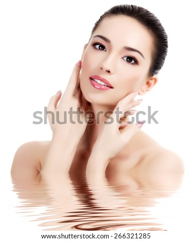Beautiful female with fresh clear skin, white background, isolated - stock photo