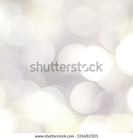 Beautiful festive glowing sparkly blue gray unfocused bokeh style abstract background. - stock photo