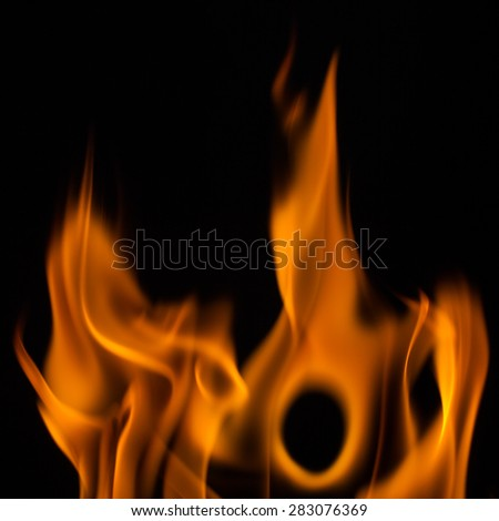 Beautiful fire flames, isolated on black background - stock photo
