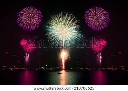 Beautiful firework display on the river - stock photo