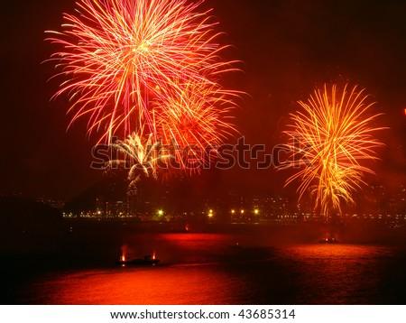 beautiful fireworks celebrating new year on the beach - stock photo