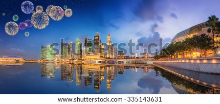 Beautiful fireworks in Marina Bay and view of skyscrapers on Singapore - stock photo