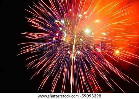 Beautiful fireworks on the black sky - stock photo