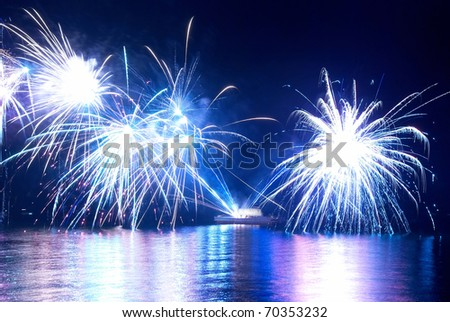 Beautiful fireworks on the black sky background - stock photo