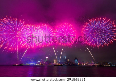 Beautiful Fireworks over Victoria Harbor in Hong Kong - stock photo