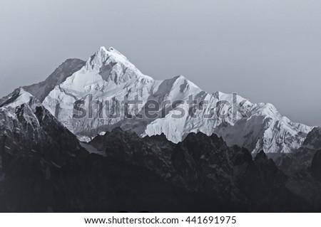 Beautiful first light from sunrise on Mount Kanchenjugha, Himalayan mountain range, Sikkim, India. Black and white stock image. - stock photo