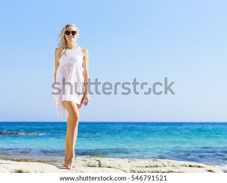 stock photo beautiful fit and sexy girl in white bikini posing on a beach at summer sea and sky background 546791521