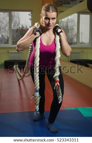 Beautiful Fit female training in a gym