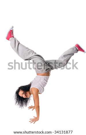 Beautiful fit girl making handstand isolated on white background - stock photo