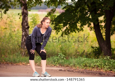 Beautiful fit runner woman jogging in nature outdoor