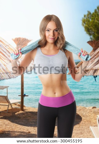 Beautiful fit woman doing a workout on the beach - stock photo