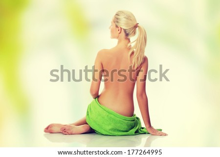 Beautiful fit woman in towel around her waist - stock photo