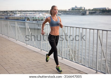 Beautiful fit young blond woman urban fitness.