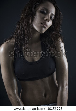 beautiful fitness body . exhausted brunette after workout - stock photo