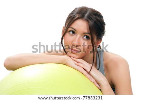 Beautiful Fitness brunette woman with yellow pilates ball for crunches workout close-up composition on a white background - stock photo