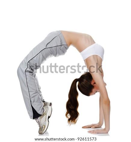 beautiful fitness girl exercising gymnastic bridge, isolated on white background - stock photo