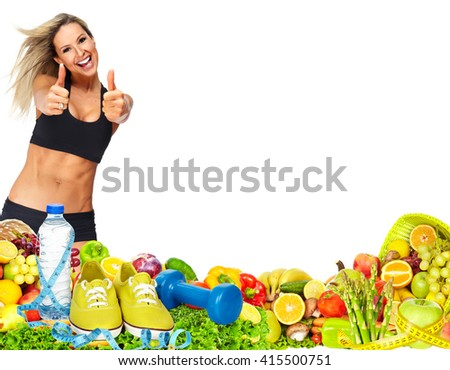 Beautiful fitness girl with fruits and vegetables. - stock photo