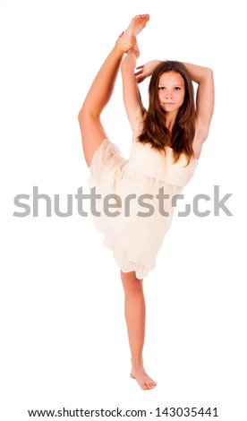 beautiful fitness woman doing stretching exercise holding one leg above , isolated - stock photo