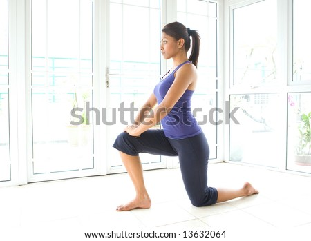 Beautiful fitness woman doing stretching for her hamstring
