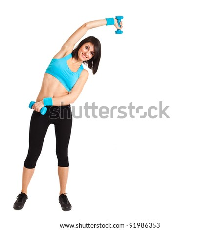 Beautiful fitness woman exercising isolated - stock photo