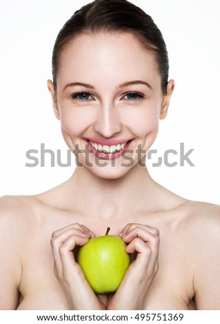Beautiful fitness woman holding healthy apple on white background
