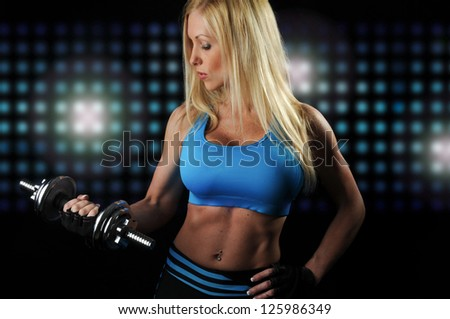 Beautiful Fitness Woman Holding Weights - stock photo