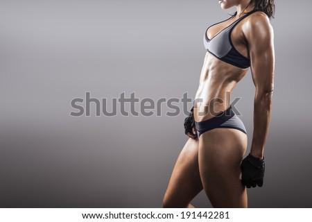beautiful fitness woman wearing a bikini - stock photo