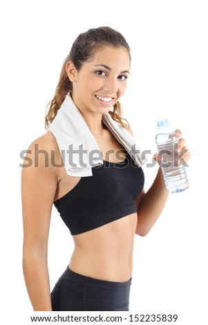 Beautiful fitness woman with a towel and a bottle of water isolated on a white background